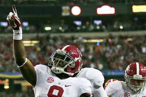 Alabama running back Bo Scarbrough (9) celebrates his touchdown run against Florida during the second half of the Southeastern Conference championship NCAA college football game, Saturday, Dec. 3, 2016, in Atlanta.(AP Photo/John Bazemore) ORG XMIT: GAMS136