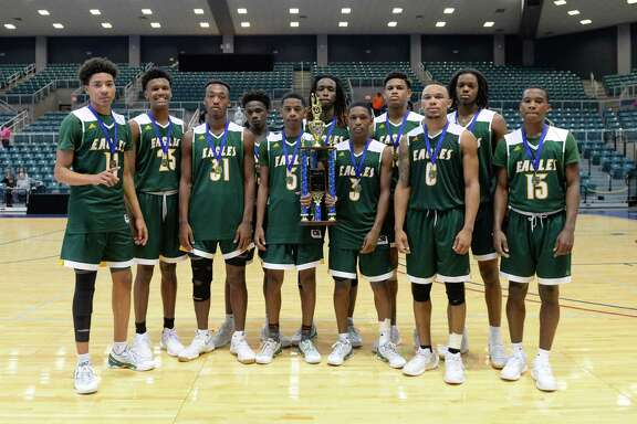 The Klein Forest Golden Eagles boys team poses after beating the Tompkins Falcons to win the Gold Bracket Championship of the Katy ISD-Phillips 66 Tournament at the Leonard Merrell Center, Katy, TX on Saturday December 3, 2016.