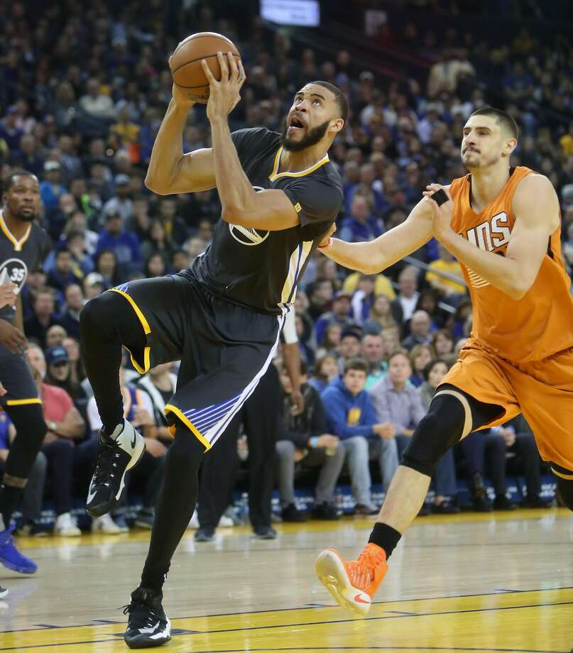 Golden State Warriors' JaVale McGee goes up to dunk against Phoenix Suns' Alex Len in 1st quarter during NBA game at Oracle Arena in Oakland, Calif., on Saturday, December 3, 2016. Photo: Scott Strazzante, The Chronicle