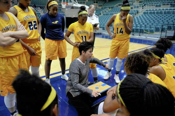 Cy Ranch head coach Tresa Martin-Hornsby discusses game strategy during the second half of a girls Gold Bracket Championship basketball game between the Cy Ranch Mustangs and Mansfield Legacy Broncos at the Katy ISD-Phillips 66 Tournament on Saturday December 3, 2016 at the Leonard Merrell Center, Katy, TX.