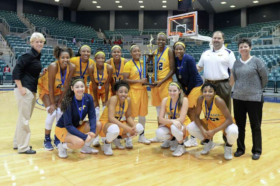 The Cy Ranch Mustangs girls team poses after beating the Mansfield Legacy Broncos to win the Gold Bracket Championship of the Katy ISD-Phillips 66 Tournament at the Leonard Merrell Center, Katy, TX on Saturday December 3, 2016. Photo: Craig Moseley, Houston Chronicle / ©2016 Houston Chronicle