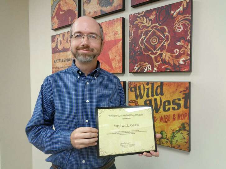 A faithful member of Dayton Historical Society was honored at their Christmas dinner Monday evening, Nov. 28. President Lester Ray Wisegerber praised Wes Williamson for his outstanding work with the Society and presented him an Award of Commendation.