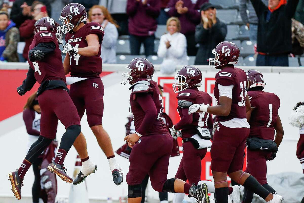 Dec. 3: Cinco Ranch 34, Cypress Ridge 17 Cinco Ranch quarterback Brant Kuithe and receiver Cameron Phelps celebrate after Kuithe scored a touchdown as Cinco Ranch beats Cypress Ridge 34-17 in the Class 6A Division II state quarterfinals at TDECU Stadium Saturday, Dec. 3, 2016 in Houston.