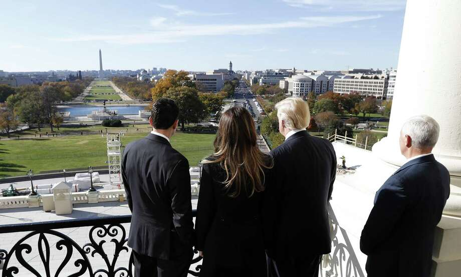 House Speaker Paul Ryan of Wis., left, shows President-elect Donald Trump, his wife Melania and Vice president-elect Mike Pence the view of the inaugural stand that is being built and Pennsylvania Avenue, from the Speaker's Balcony on Capitol Hill in Washington, Thursday, Nov. 10, 2016. (AP Photo/Alex Brandon) Photo: Alex Brandon / Associated Press / Copyright 2016 The Associated Press. All rights reserved.
