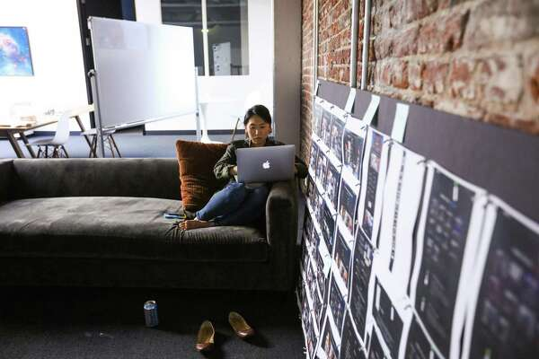 Cherry Park Barratt gets comfortable on a couch while she works on her computer at Imgur's offices in San Francisco. Some of the influence of millennials is already easy to spot, as more workplaces replace cubicles with sofas and include amenities such as coffee bars. These tweaks to the office decor are just some of the ways that companies are trying to get most out of the innovative, 24/7 pace of a generation that grew up with the internet, hovering helicopter parents and tightly orchestrated lives.