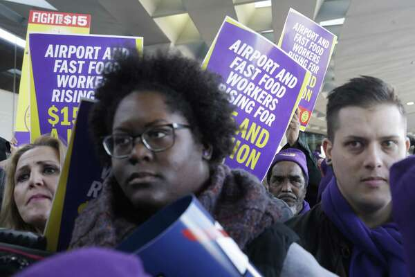 On the front lines, airline employees are reaping billions of dollars in wage and benefit increases, plus profit-sharing plans that spell record payouts amid record income. Yet this largesse hasn't been spread equally. Protesters gather at Chicago's O'Hare International Airport on Tuesday as part of a nationwide protest for a $15 per hour minimum wage.