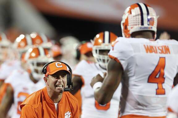 Clemson coach Dabo Swinney is the first to congratulate Deshaun Watson after one of the QB's three touchdown passes against Virginia Tech.