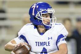 Reid     Hesse   (4) of the Temple Wildcats drops back to the pass in the first half against the George Ranch Longhorns in high school football's Class 5A Division I state quarterfinals on Friday, December 4, 2015 at Berry Center Stadium.