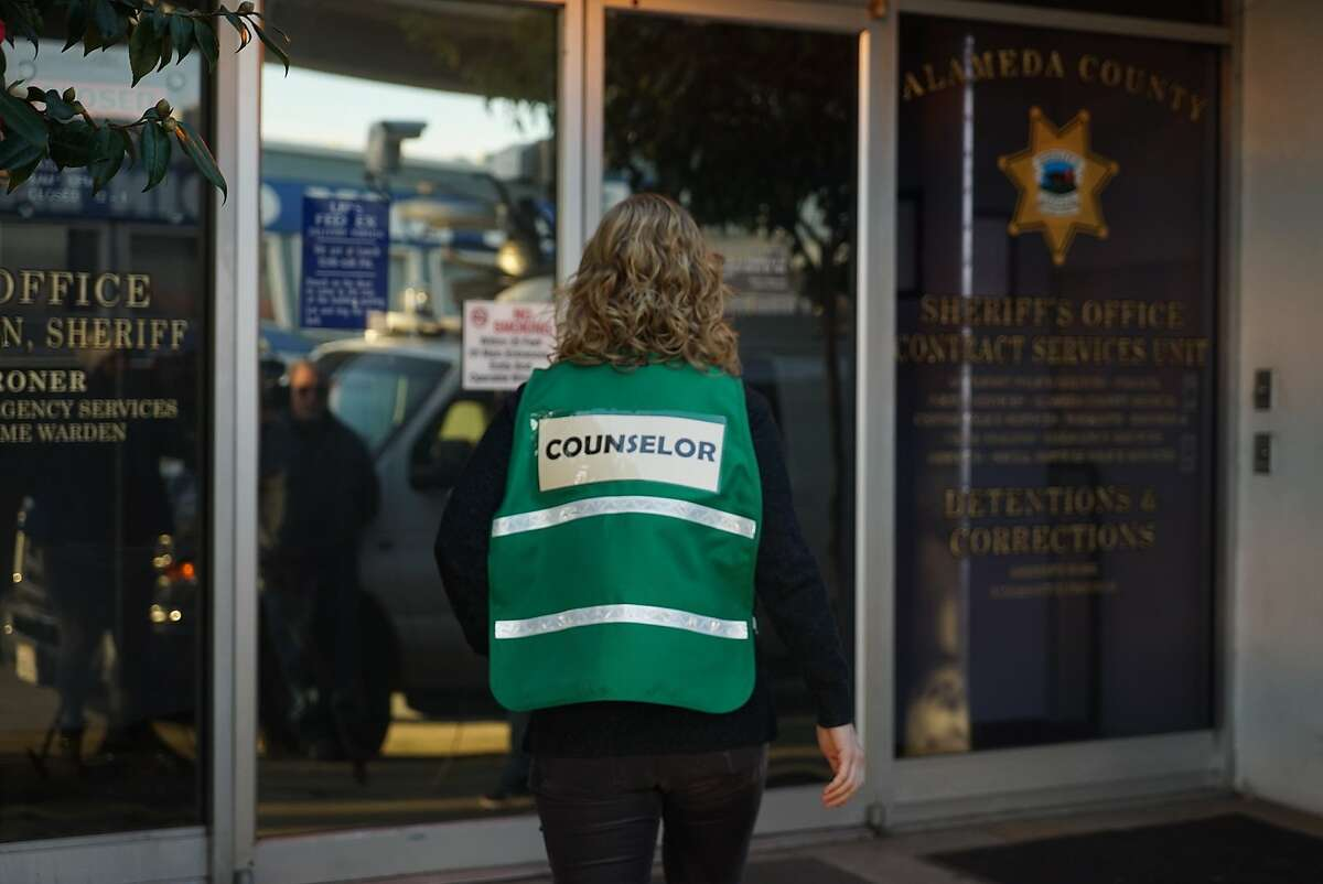 A counselor walks into the Sheriff's office in Oakland, Calif. on Sunday, Dec. 4, 2016. The office is providing information to those who may have lost a loved one in the Ghost Ship fire.