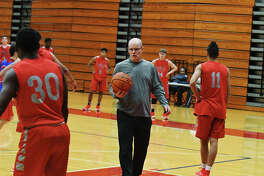 Tomball Basketball head coach Brad Ball directs traffic during practice last week. Ball said that his roster of 14 players is getting plenty of work, playing a fast-paced, up-and-down brand of hoops.