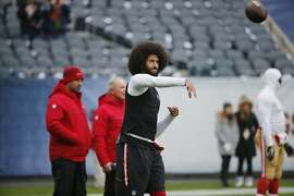 San Francisco 49ers quarterback Colin Kaepernick warms up before an NFL football game against the Chicago Bears, Sunday, Dec. 4, 2016, in Chicago. (AP Photo/Charles Rex Arbogast)