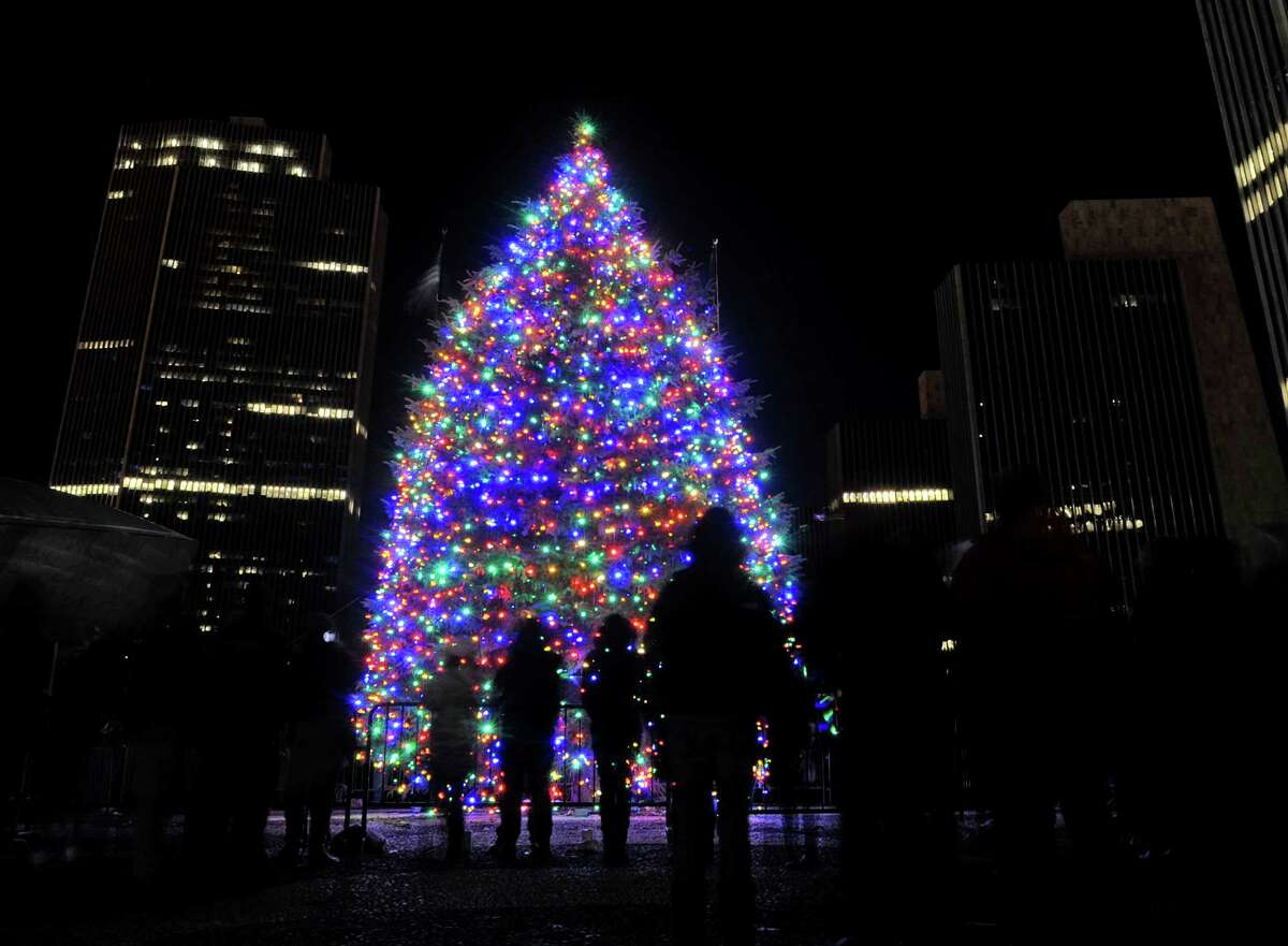 Children look over the lights during the tree lighting ceremony for the New York State tree at the Empire State Plaza on Sunday, Dec. 7, 2014, in Albany, N.Y. (Paul Buckowski / Times Union)