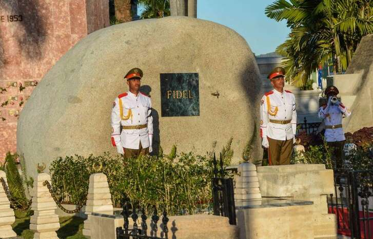 A guard of honour stays by the tomb of Cuban leader Fidel Castro at the Santa Ifigenia cemetery in Santiago de Cuba on December 4, 2016. Fidel Castro's ashes were buried alongside national heroes in the cradle of his revolution on Sunday, as Cuba opens a new era without the communist leader who ruled the island for decades. / AFP PHOTO / AIN / Marcelino VAZQUEZMARCELINO VAZQUEZ/AFP/Getty Images