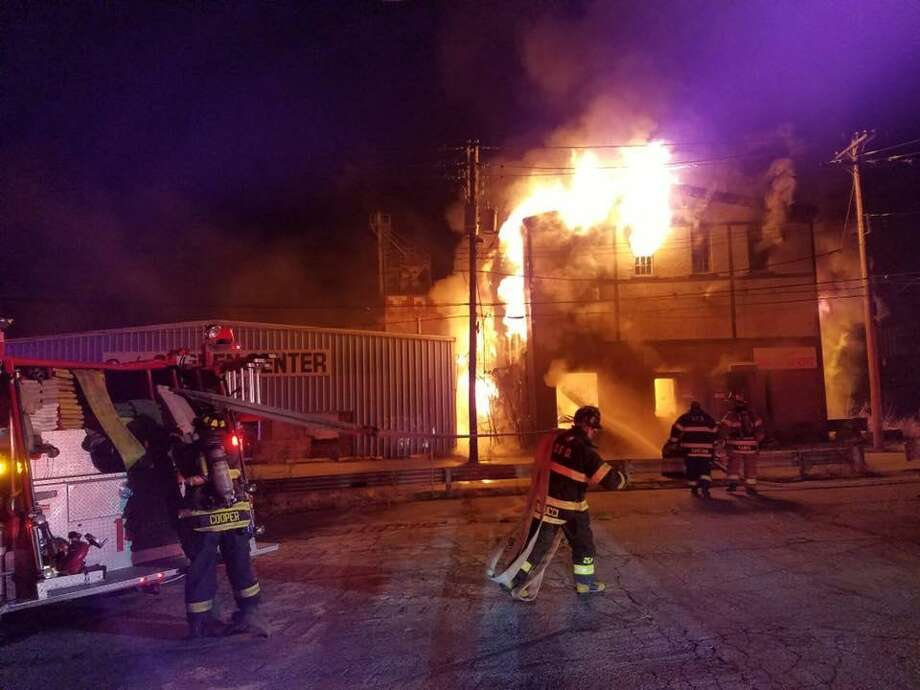 Several crews from area towns extinguished a fully-engulfed fire at a three-story vacant building on Caroline Street in De the morning of Sunday, Dec. 4. No one was injured. Photo courtesy of Chief Kurt Kemmesies, Derby Fire Department. Photo: Chief Kurt Kemmesies, /Derby Fire Department / Contributed Phot