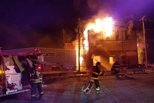 Several crews from area towns extinguished a fully-engulfed fire at a three-story vacant building on Caroline Street in De the morning of Sunday, Dec. 4. No one was injured. Photo courtesy of Chief Kurt Kemmesies, Derby Fire Department.