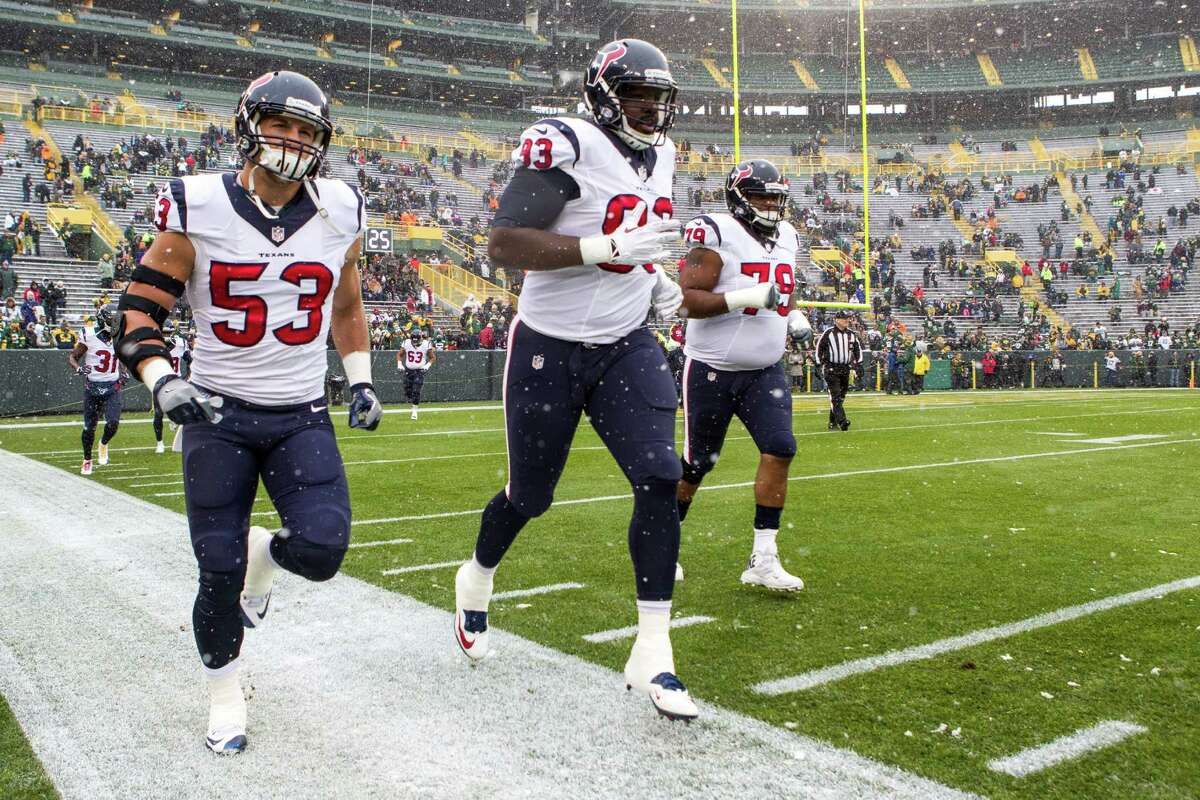 Houston Texans inside linebacker Max Bullough (53), defensive end Joel Heath (93) and guard Jeff Allen (79) run onto the field for warm ups before an NFL football game against the Green Bay Packers at Lambeau Field on Sunday, Dec. 4, 2016, in Green Bay.