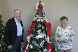 Pat Mange (right) and Joe Bob Croley (left) of the Cleveland Historical Society decorated their Christmas tree with photos depicting the history of Cleveland. Their tree won first place in the Hometown Christmas tree Contest.