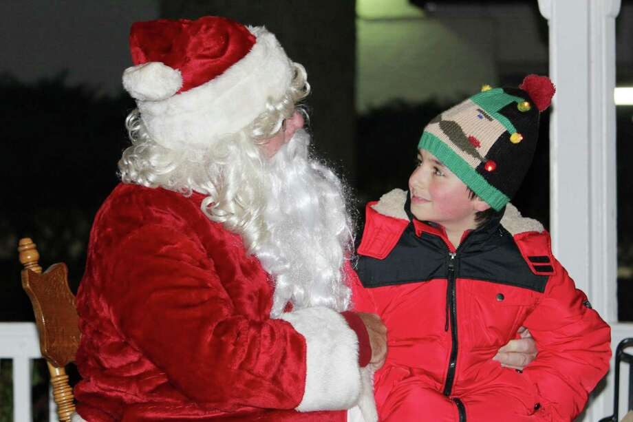 KC Mercer meets Santa Claus at the annual Wilton Holiday Stroll on Friday, Dec. 2 at Town Center. Photo: Stephanie Kim / Hearst Connecticut Media