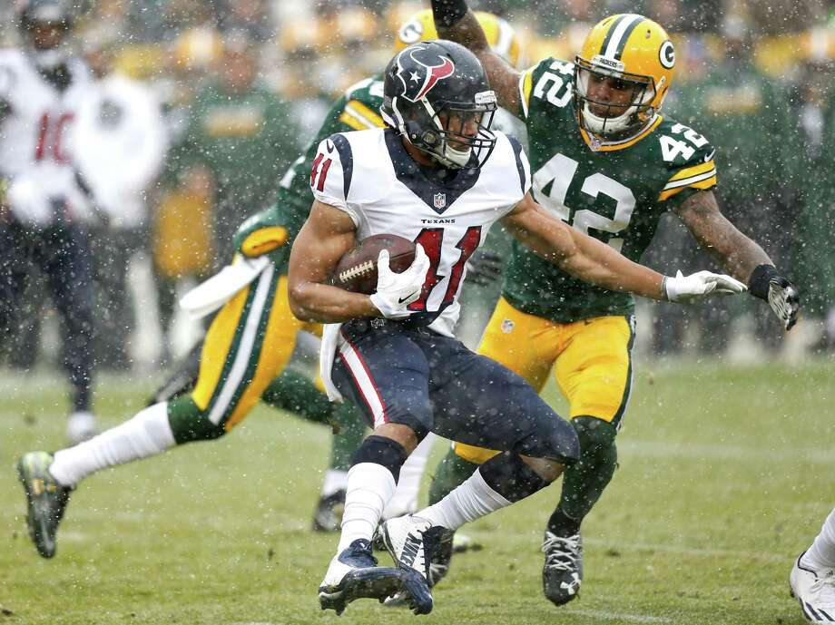 Houston Texans running back Jonathan Grimes (41) runs the ball against Green Bay Packers strong safety Morgan Burnett (42) during the first quarter of an NFL football game at Lambeau Field on Sunday, Dec. 4, 2016, in Green Bay. Photo: Brett Coomer, Houston Chronicle / © 2016 Houston Chronicle