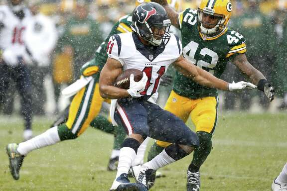 Houston Texans running back Jonathan Grimes (41) runs the ball against Green Bay Packers strong safety Morgan Burnett (42) during the first quarter of an NFL football game at Lambeau Field on Sunday, Dec. 4, 2016, in Green Bay.