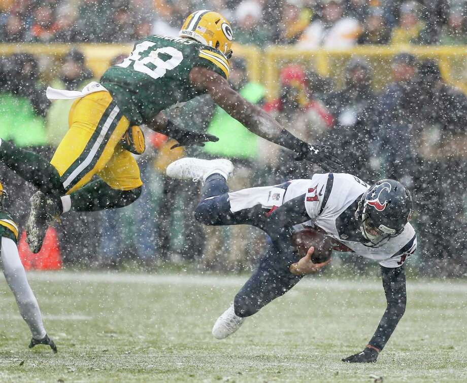 Houston Texans quarterback Brock Osweiler (17) is brought down by Green Bay Packers inside linebacker Joe Thomas (48) as he scrambles out of the pocket during the first quarter of an NFL football game at Lambeau Field on Sunday, Dec. 4, 2016, in Green Bay. Photo: Brett Coomer, Houston Chronicle / © 2016 Houston Chronicle