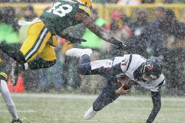Houston Texans quarterback Brock Osweiler (17) is brought down by Green Bay Packers inside linebacker Joe Thomas (48) as he scrambles out of the pocket during the first quarter of an NFL football game at Lambeau Field on Sunday, Dec. 4, 2016, in Green Bay.