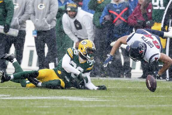 Houston Texans tight end Ryan Griffin (84) fumbles as he is hit by Green Bay Packers cornerback LaDarius Gunter (36) during the first quarter of an NFL football game at Lambeau Field on Sunday, Dec. 4, 2016, in Green Bay. The Packers recovered the fumble for a turnover.