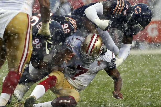 San Francisco 49ers quarterback Colin Kaepernick (7) fumbles as he is tackled by Chicago Bears defensive end Akiem Hicks (96) and linebacker Leonard Floyd (94) during the second half of an NFL football game, Sunday, Dec. 4, 2016, in Chicago. (AP Photo/Nam Y. Huh)