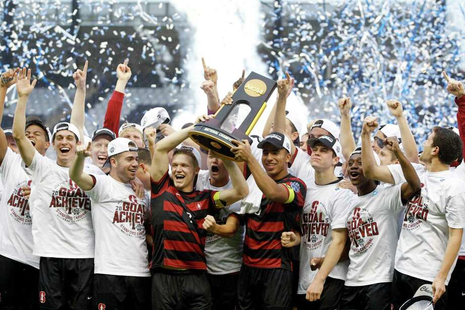 Members of the Stanford soccer team celebrates after winning the NCAA College Cup championship soccer match against Clemson, Sunday, Dec. 13, 2015, in Kansas City, Kan. Stanford defeated Clemson 4-0. (AP Photo/Colin E. Braley) Photo: Colin E. Braley, Associated Press / FR123678 AP