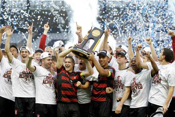 Members of the Stanford soccer team celebrates after winning the NCAA College Cup championship soccer match against Clemson, Sunday, Dec. 13, 2015, in Kansas City, Kan. Stanford defeated Clemson 4-0. (AP Photo/Colin E. Braley)