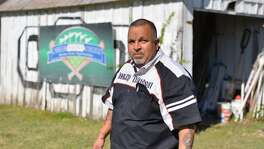 Pastor Jimmy Robles of Last Chance Ministries looks over the ministry baseball fields. Maimtainence issues have arisen due to now-defunct Career Point College not paying it's sponsorship.
