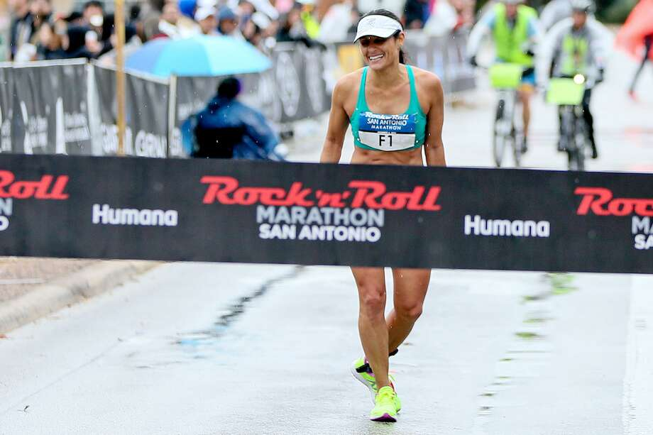 Liza Hunter-Galvan of San Antonio stops to give a curtsey in front of the finish line of the marathon during the 9th annual Rock 'n' Roll San Antonio Marathon & Half Marathon on Sunday, Dec. 4, 2016.  Hunter-Galvan was the first woman finisher with a time  of 2:5717.  MARVIN PFEIFFER/ mpfeiffer@express-news.net Photo: Marvin Pfeiffer, Staff / San Antonio Express-News / Express-News 2016