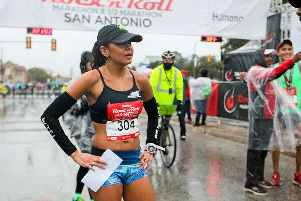 Anita Perez stands in back of the finish line of the half marathon during the 9th annual Rock 'n' Roll San Antonio Marathon & Half Marathon on Sunday, Dec. 4, 2016.  Perez was the first woman finisher in the event with a time of 1:20.46.  MARVIN PFEIFFER/ mpfeiffer@express-news.net