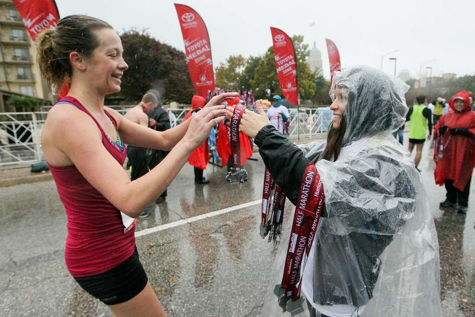 A half marathon finisher receives her medal during the 9th annual Rock 'n' Roll San Antonio Marathon & Half Marathon on Sunday, Dec. 4, 2016.  MARVIN PFEIFFER/ mpfeiffer@express-news.net
