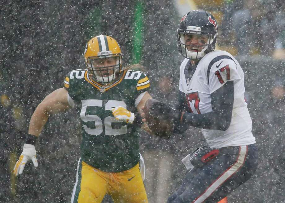 Houston Texans' Brock Osweiler scrambles to get away from Green Bay Packers' Clay Matthews (52) during the first half of an NFL football game Sunday, Dec. 4, 2016, in Green Bay, Wis. (AP Photo/Mike Roemer) Photo: Mike Roemer, FRE / FR155603 AP