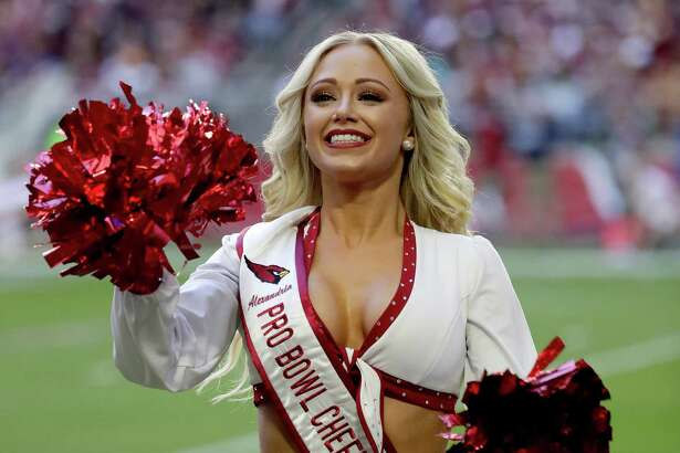 The Arizona Cardinals cheerleaders perform during the first half of an NFL football game against the Washington Redskins, Sunday, Dec. 4, 2016, in Glendale, Ariz. (AP Photo/Rick Scuteri)