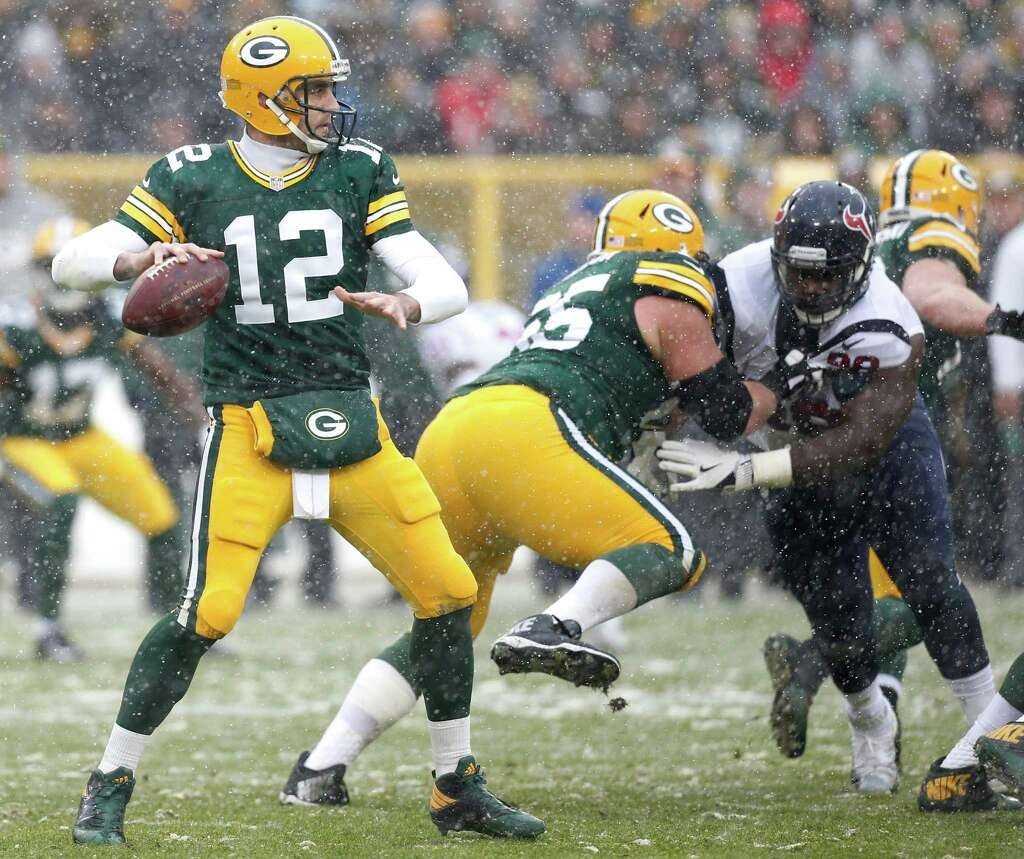 Green Bay Packers quarterback Aaron Rodgers (12) drops back to pass against the Houston Texans during the second quarter of an NFL football game at Lambeau Field on Sunday, Dec. 4, 2016, in Green Bay. -Photo: Brett Coomer, Houston Chronicle