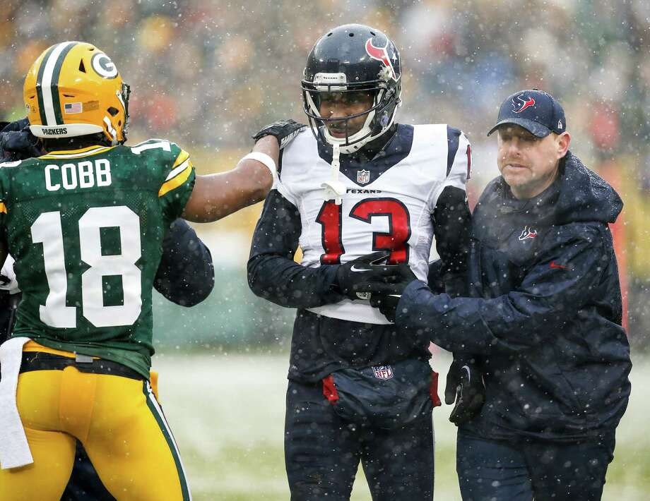 Houston Texans wide receiver Braxton Miller (13) is consoled by Green Bay Packers wide receiver Randall Cobb (18) as Miller leaves the field with trainer Geoff Kaplan after suffering an injury during the second quarter of an NFL football game at Lambeau Field on Sunday, Dec. 4, 2016, in Green Bay. Photo: Brett Coomer, Houston Chronicle / © 2016 Houston Chronicle