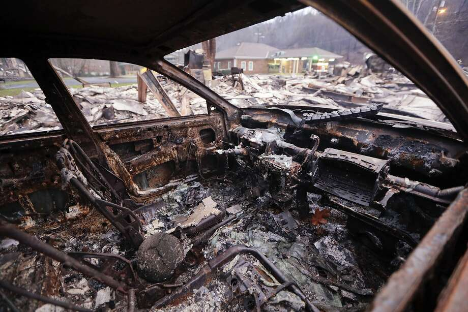 A car destroyed by a wildfire rests in a parking lot last week in Gatlinburg, Tenn. Many survivors need help to cope, and problems like nightmares, depression and anxiety might not show up for months. Photo: Mark Humphrey, Associated Press