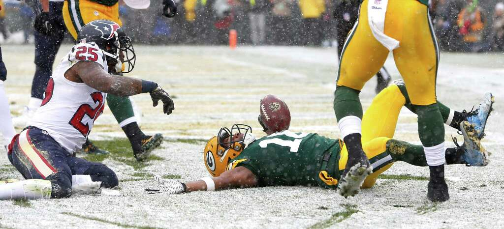 Snow Angel: Green Bay Packers wide receiver Randall Cobb (18) celebrates his 9-yard touchdown reception after beating Houston Texans cornerback Kareem Jackson (25) in the end zone during the second quarter of an NFL football game at Lambeau Field on Sunday, Dec. 4, 2016, in Green Bay. -Photo: Brett Coomer, Houston Chronicle