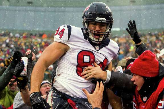 Houston Texans tight end Ryan Griffin (84) jumps into the stands after scoring on a 6-yard touchdown reception against the Green Bay Packers during the third quarter of an NFL football game at Lambeau Field on Sunday, Dec. 4, 2016, in Green Bay.