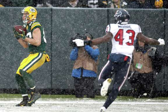 Green Bay Packers wide receiver Jordy Nelson (87) backs into the end zone with Houston Texans strong safety Corey Moore (43) defending as he makes a 32-yard touchdown reception during the fourth quarter of an NFL football game at Lambeau Field on Sunday, Dec. 4, 2016, in Green Bay.