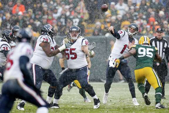 Houston Texans quarterback Brock Osweiler (17) throws a pass over Green Bay Packers defensive end Datone Jones (95) during the second quarter of an NFL football game at Lambeau Field on Sunday, Dec. 4, 2016, in Green Bay.