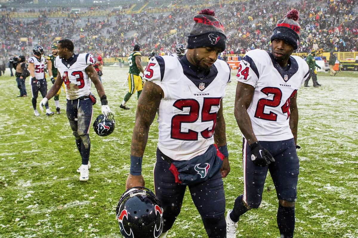 Houston Texans cornerbacks Kareem Jackson (25) and Johnathan Joseph (24) walk off the field after the Texans lost to the Green Bay Packers 21-13 at Lambeau Field on Sunday, Dec. 4, 2016, in Green Bay.
