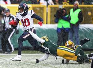 Houston Texans wide receiver DeAndre Hopkins (10) runs past Green Bay Packers strong safety Micah Hyde (33) and cornerback Damarious Randall (23) on his way to a 44-yard touchdown reception during the fourth quarter of an NFL football game at Lambeau Field on Sunday, Dec. 4, 2016, in Green Bay.
