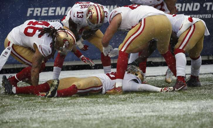 San Francisco 49ers cornerback Dontae Johnson (36) makes a snow angle in the end zone after a play during the first half of an NFL football game against the Chicago Bears, Sunday, Dec. 4, 2016, in Chicago. (AP Photo/Nam Y. Huh)