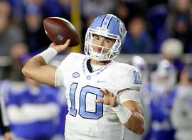 DURHAM, NC - NOVEMBER 10:  Mitch Trubisky #10 of the North Carolina Tar Heels thows a pass against the Duke Blue Devils during their game at Wallace Wade Stadium on November 10, 2016 in Durham, North Carolina.  (Photo by Streeter Lecka/Getty Images)