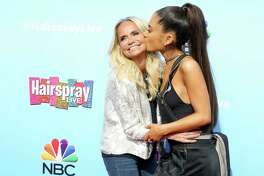 """Kristin Chenoweth, left, and Ariana Grande arrive at the """"Hairspray Live!"""" Press Junket at the Universal Lot on Wednesday, Nov. 16, 2016, in Universal City, Calif. (Photo by Rich Fury/Invision/AP) ORG XMIT: CARF108"""