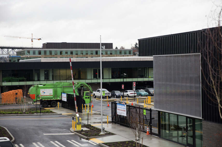 A garbage truck pulls into the newly renovated and reopened Seattle Public Utilities North Transfer Station, on Friday, Dec. 2, 2016. Photo: GRANT HINDSLEY, SEATTLEPI.COM / GRANT HINDSLEY