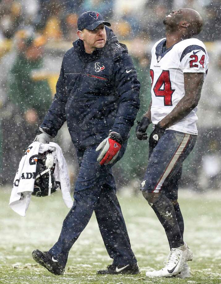 Houston Texans cornerback Johnathan Joseph (24) walks off the field with trainer Geoff Kaplan after suffering an injury during the third quarter of an NFL football game against the Green Bay Packers at Lambeau Field on Sunday, Dec. 4, 2016, in Green Bay. Photo: Brett Coomer, Houston Chronicle / © 2016 Houston Chronicle